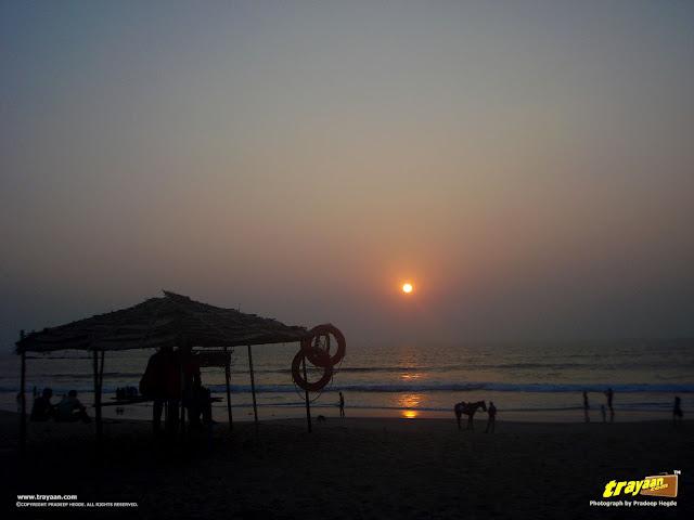 Lifeguards, people, and the sunset at Tannirbavi Beach, Mangalore, Dakshina Kannada, Karnataka, India