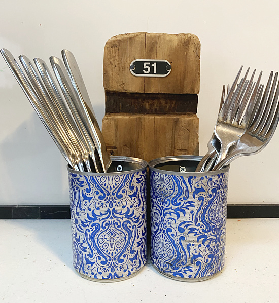 aluminum can caddie with forks and knives
