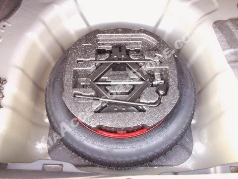 http://www.kiaaccessorystore.com/kia_optima_spare_tire_kit.html