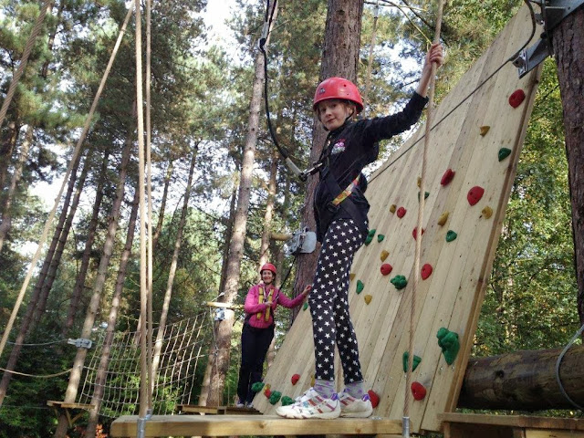 Eldest girl doing tree trekking at center parcs