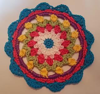 http://redhairedamazona.blogspot.com.au/2016/06/happy-flower-crochet-mandala.html