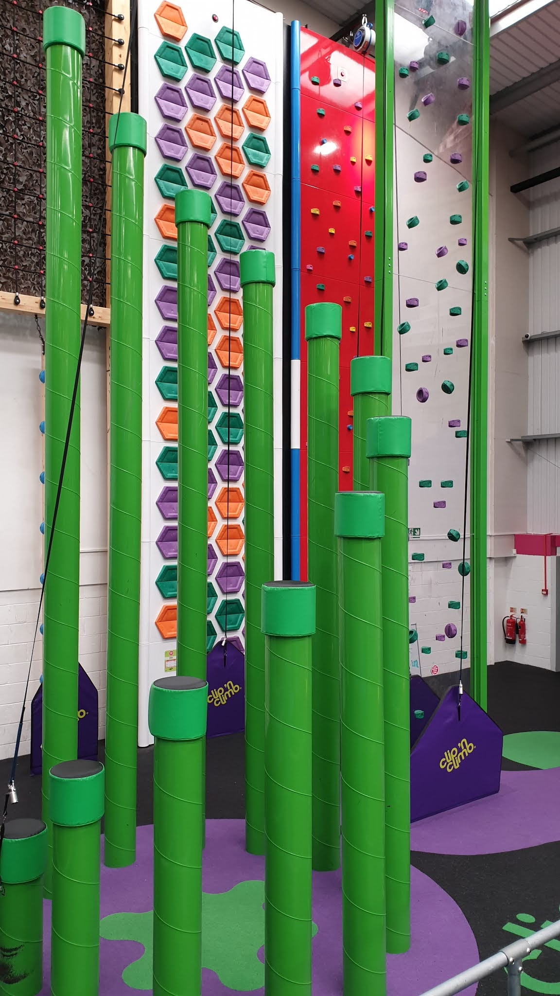 jump in trampoline park climbing area