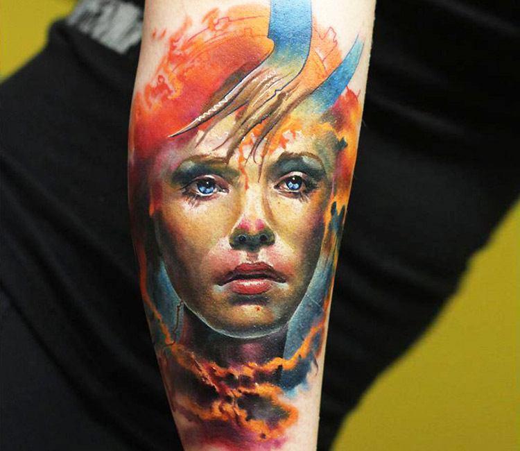 Tatuaje de un rostro en acuarelado