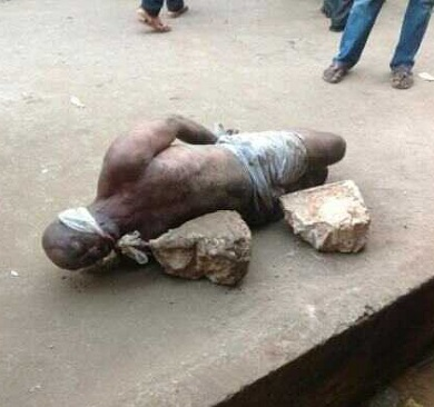 See Photos of Pastor Gruesomely KILLED Inside Gutter; Hands, Feet, Head Tied To A Big Stone