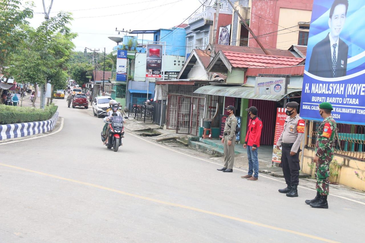 Polres Barito Utara bersama Tim Satgas Covid-19 Laksanakan Pendisiplinan Protokol Kesehatan di Sejumlah Ruas Jalan