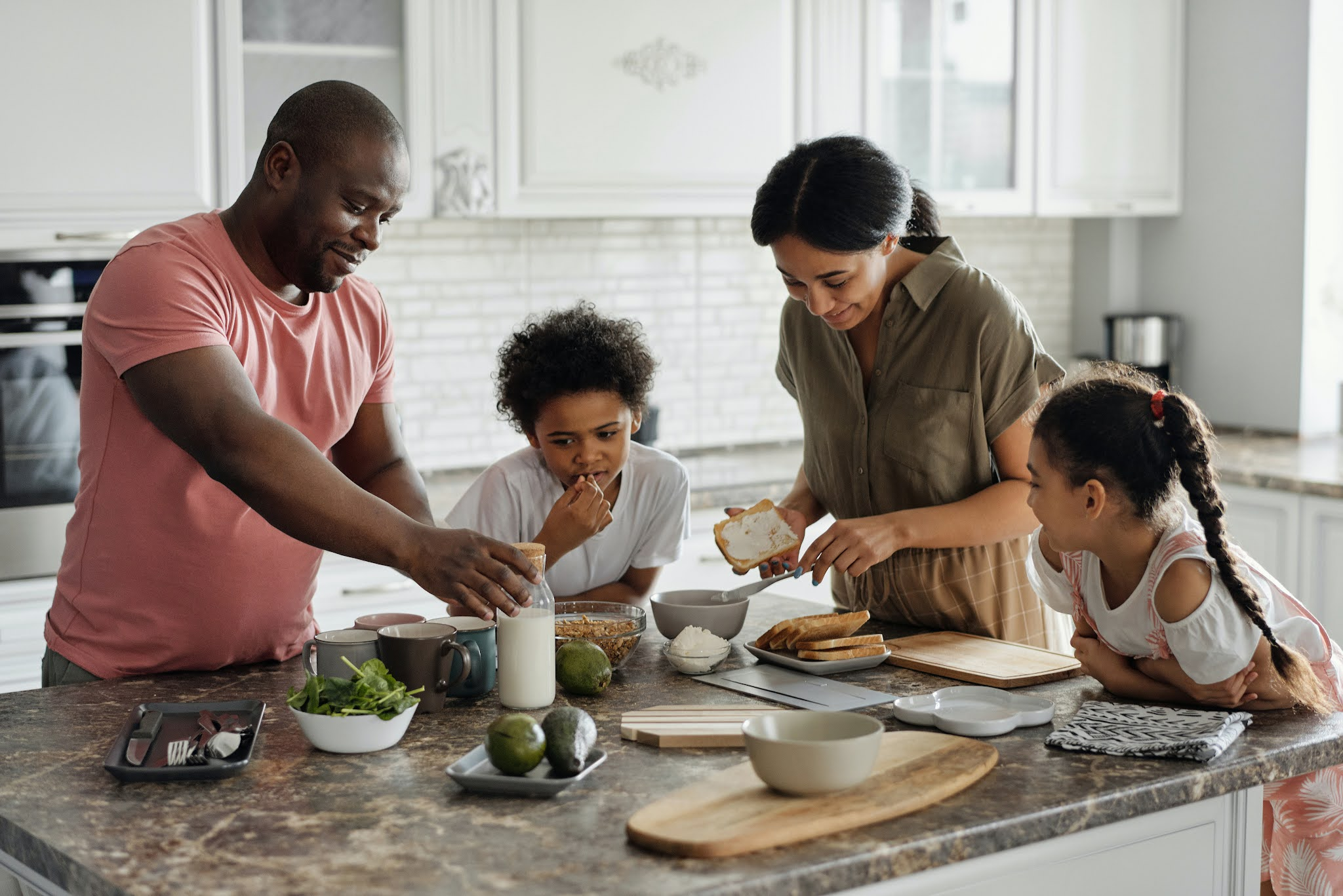 A family cooking together. Photo by August de Richelieu from Pexels