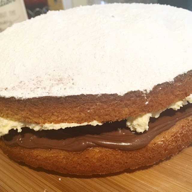 Plain Victoria sponge with nutella and whipped double cream