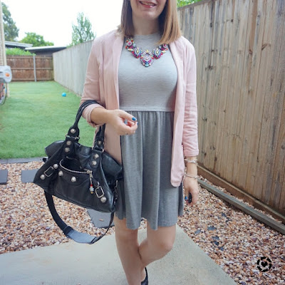 awayfromtheblue Instagram blush blazer with grey skater dress statement necklace and black Balenciaga part time bag