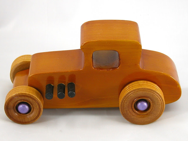 Top Left Side -  Wooden Toy Car - Hot Rod Freaky Ford - 27 Coupe - Pine - Amber Shellac - Metallic Purple Hubs