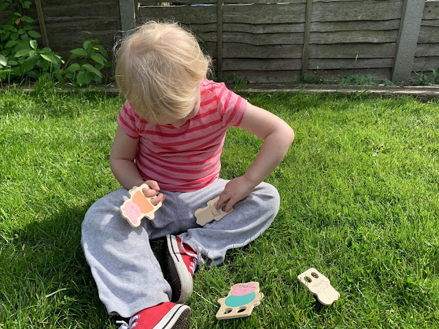 Toddler playing with Peppa Pig Wooden Finger Puppets