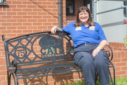 Woman sat on Cats Protection bench