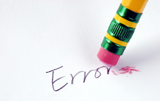 "Image of pencil with an eraser, and the word ""Error"""