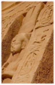 stone statue of Nefertari on Lesser temple wearing the double feathered plumed headdress of Amun and the Head priestess of Amun