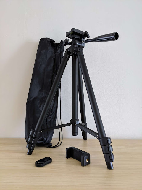 Phinistec tripod with some accessories: carrying pouch, phone adapter, Bluetooth shutter