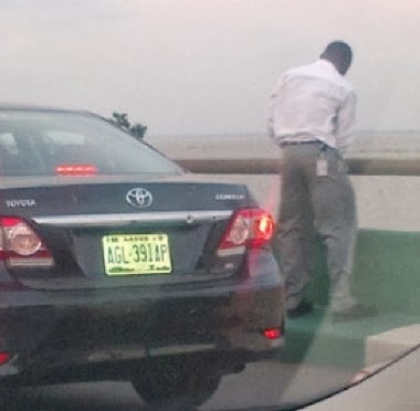 man urinating third mainland bridge