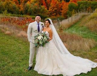 Emumita Bonita with her husband Nickmercs in their wedding dress