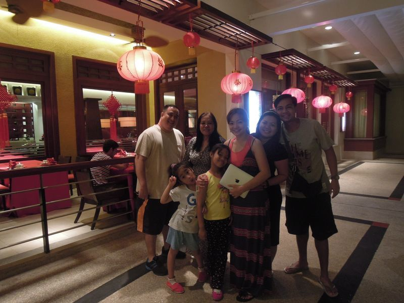 Family photo in front of Tea of Spring at Shangri-La's Mactan Resort and Spa