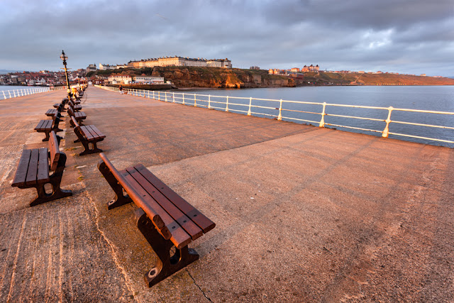 Sunrise image of Whitby pier in North Yorkshire by Martyn Ferry Photography