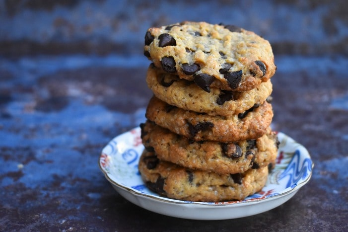 Easy Vegan Peanut Butter Chocolate Chip Cookies in a stack on a small teaplate