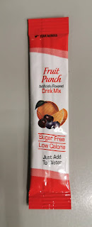 A single packet of magical powder from Essential Everyday Light Fruit Punch Mix
