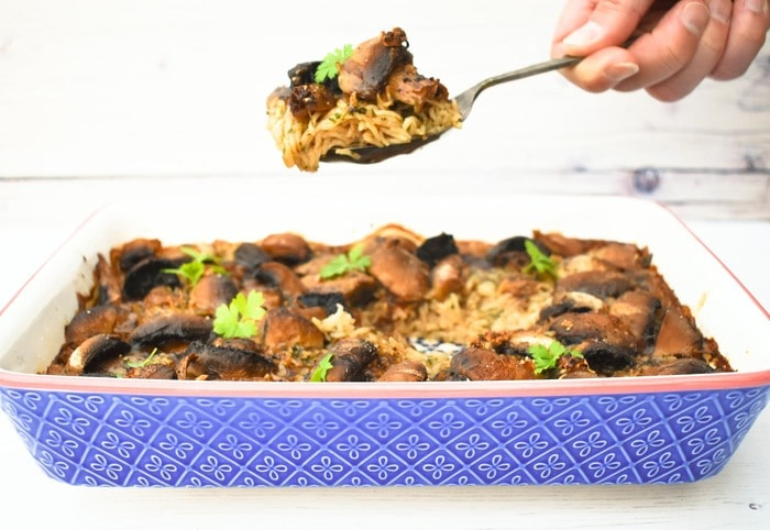 Mushroom Rice Bake with Gravy in a blue casserole dish