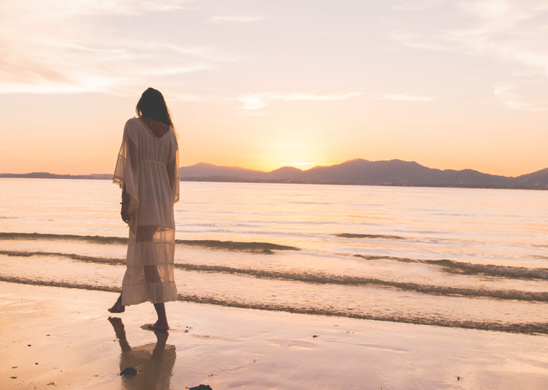Lady walking along the beach in a post about five easy ways to improve your life