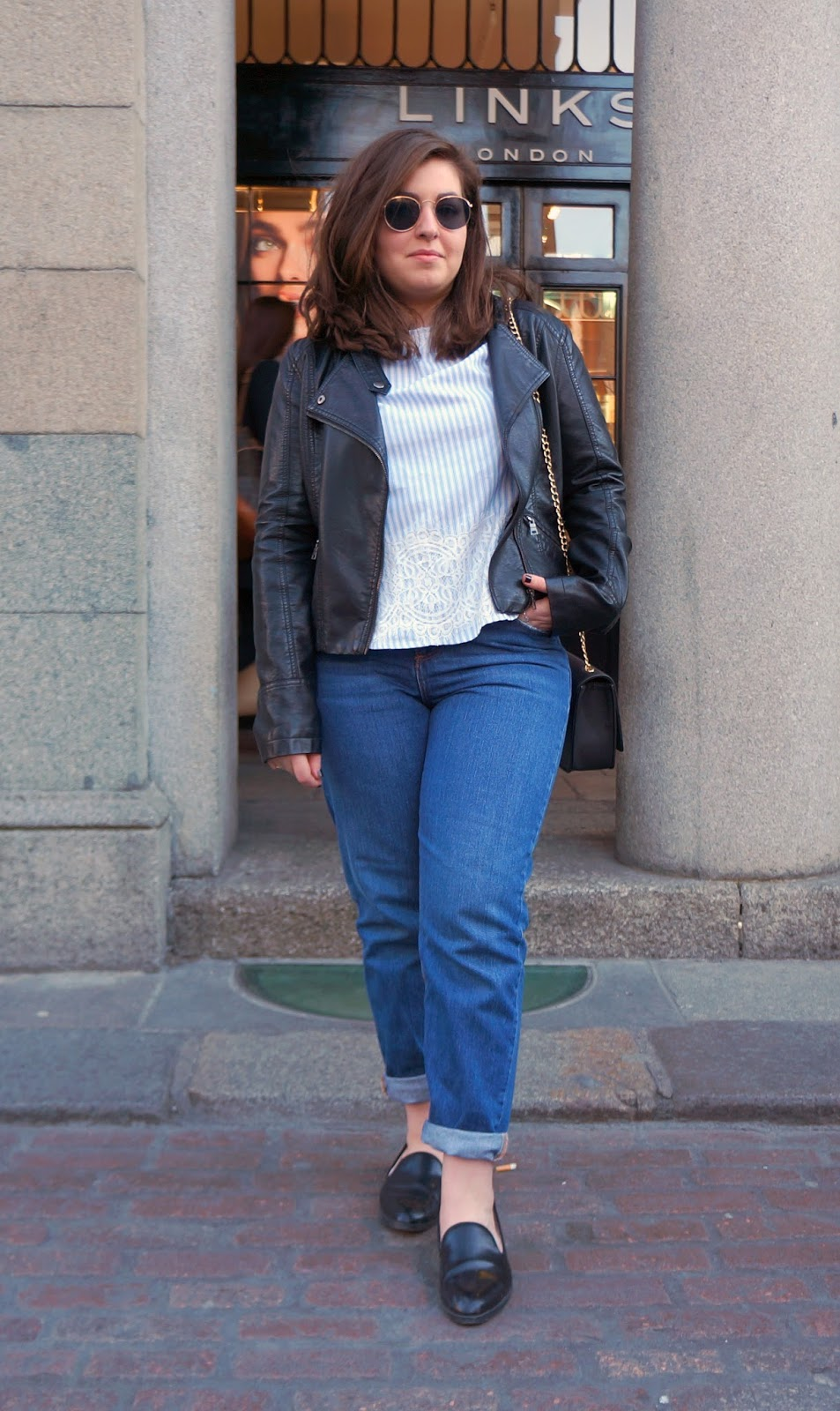 Full outfit styled with leather jacket