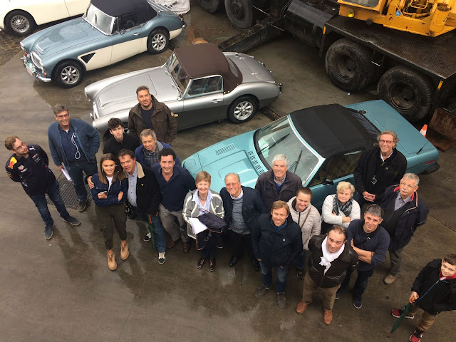 group picture of participant in a classic car rally for charity against cancer