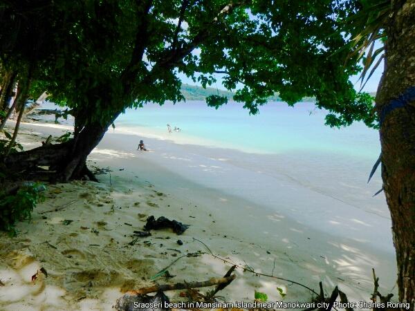 White sandy beach in tropical Mansinam island near Manokwari city