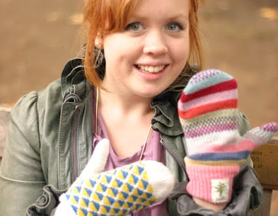 woman with pair of unmatched mittens