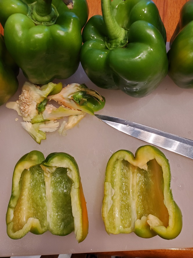 these are green bell peppers sliced in half and cleaned