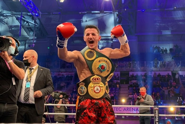 Albanian boxer Robin Krasniqi celebrating in the ring the victory of the world champion in IBO and WBA after defeating the German boesel