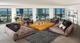 Cozy Sitting Space with Wide Low Wooden Coffee Table and Brown Modern Sofa Bed on Grey Rug