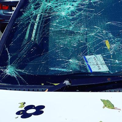 Close up of a car windscreen covered in cracks.