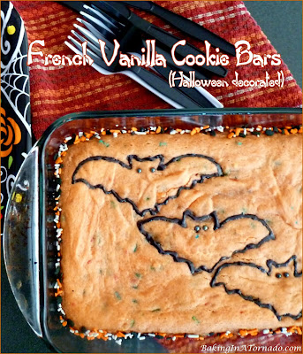 French Vanilla Cookie Bars pictured decorated for Halloween but perfect for any occasion. Starting with mixes for ease, just add a few ingredients, bake and decorate. | Recipe developed by www.BakingInATornado.com | #recipe #bake