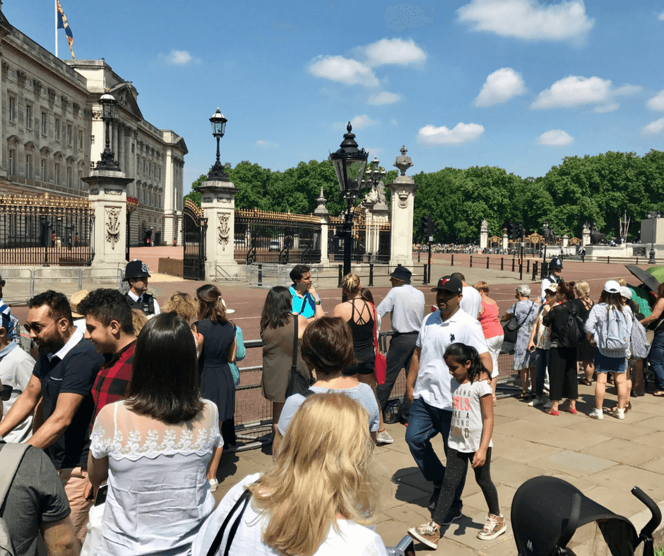 People crowded on paths close to Buckingham Palace