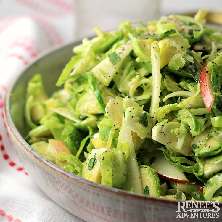 Shaved Brussels Sprouts Salad with Apples and Ginger in bowl ready to eat.