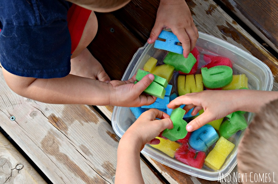 Water sensory play using alphabet sponges from And Next Comes L