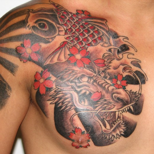 Koi Fish Chest Plate Tattoo Covering Scar: Tattoo Today's: 16 Outstanding Chest Plate Tattoo Designs