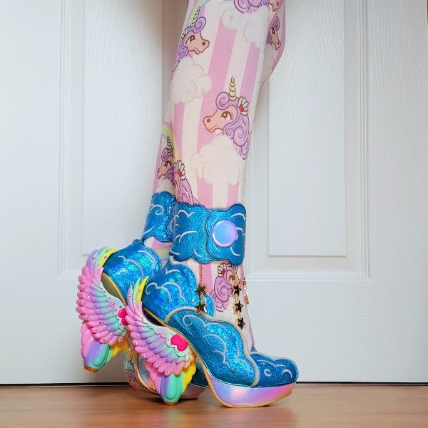 wearing bright blue shoes with ankle cuff and rainbow winged heel with seahorse striped tights