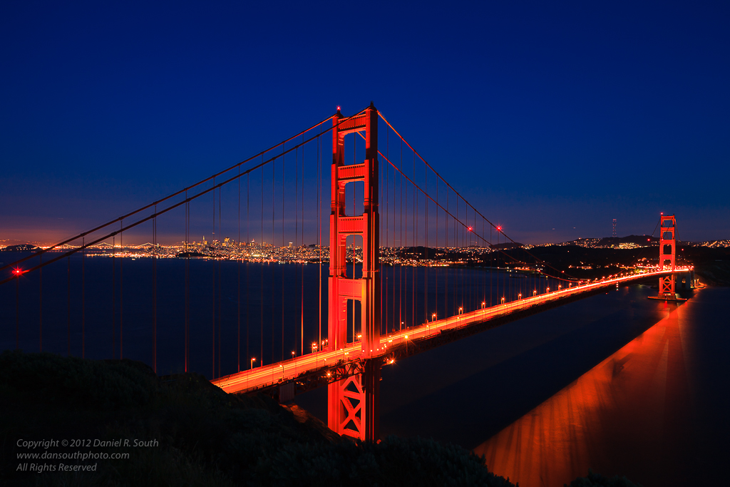 a photo of the golden gate bridge at dusk with traffic trails