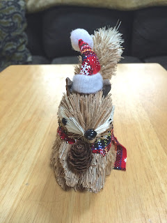 Christmas Squirrel Holding a Pine Cone