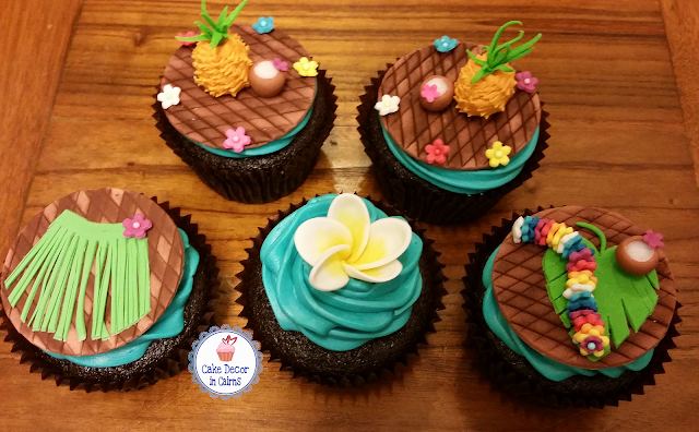 Fondant Gumpaste Pineapple. Grass skirt frangipanni tropical leaf flower necklace chocolate cupcakes