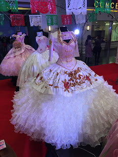 https://www.houstonquinceanera.com/la-glitter-quinceanera-dresses