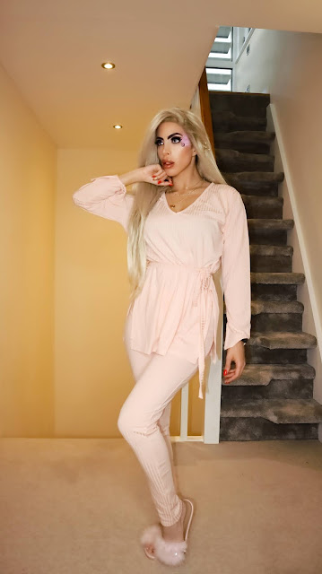 The Femme Luxe Pink Ribbed Belted Loungewear Set in model Asia