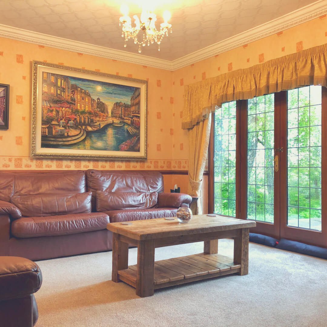 A lounge with a huge painting hanging on the wall that was bought from Walt Disney World