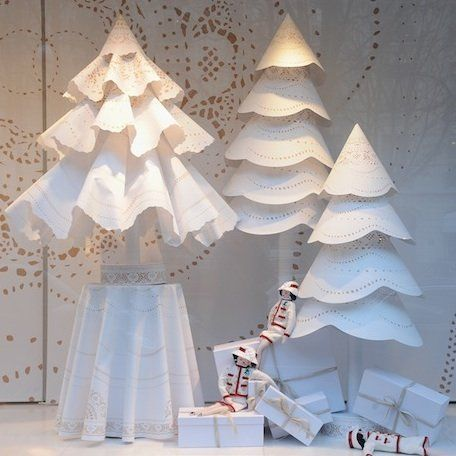 Paris shop window decor with white Christmas trees #ParisChristmas #FrenchChristmas #whiteChristmas