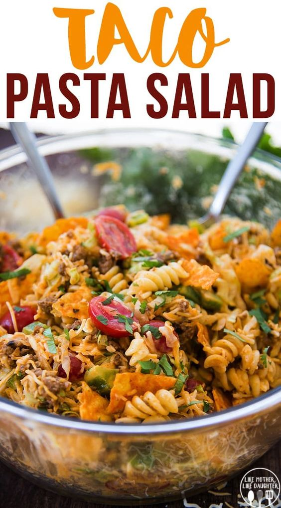 Taco Pasta Salad is a delicious pasta salad made with Mexican flavors, seasoned ground beef, crunchy nacho cheese chips, and a delicious creamy dressing! Perfect for a summer potluck or BBQ!