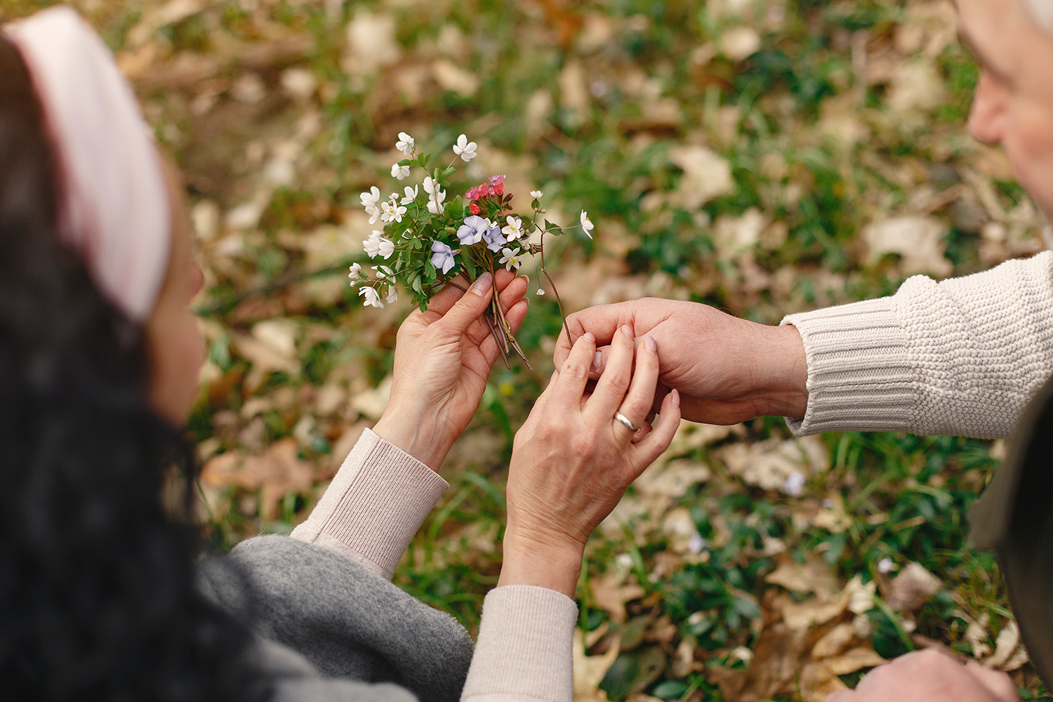 a picture of a wild flower bouquete in the hands of happy woman