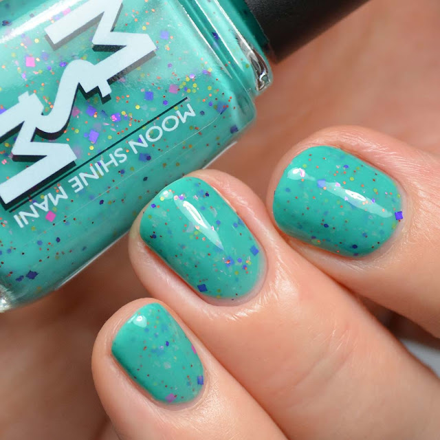 teal crelly nail polish with glitter swatch